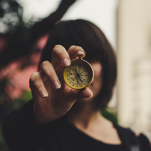 photo-of-woman-holding-compass-1827215-qu